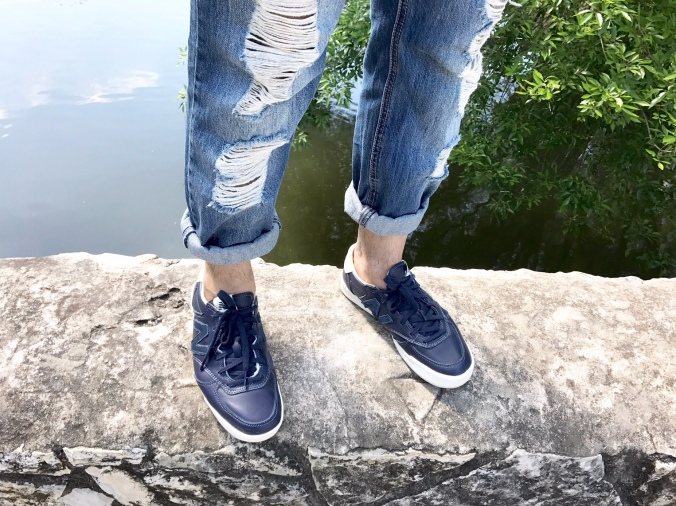 New Balance Shoes and Torn Jeans
